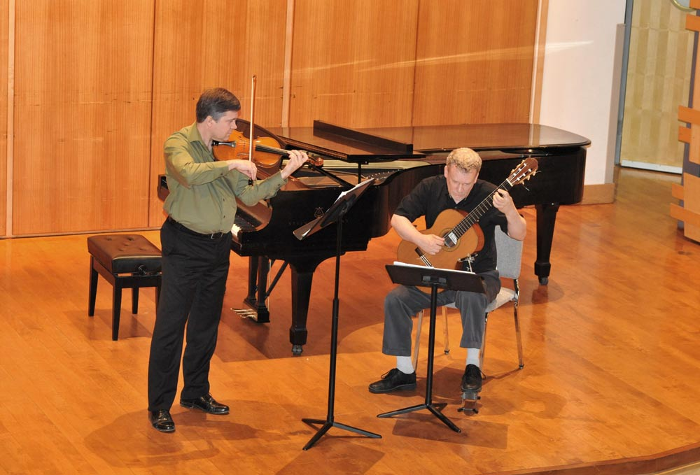 Eric Lawson and Jeff Anvinson onstage at Rock Hall, Philadelphia, performing Mahle's Sonata for Violin and Guitar