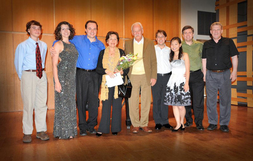 Ernst and Cidinha Mahle posing with musicians after a concert of Mahle's music in Rock Hall, Philadelphia